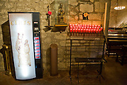A vending machine selling votive candles in the cathedral in the town of Pals, Costa Brava, Spain. Pals is a medieval town in Catalonia a few kilometres from the sea in the heart of the Bay of Emporda on the Costa Brava.