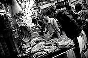 Hong Kong | HongKong | 02.12.2012 :  <br /> <br /> hier: Fleischer auf einer Einkaufsstrasse auf Hong Kong Island<br />   <br /> Sascha Rheker<br /> 20121202<br /> <br /> <br /> <br /> [Inhaltsveraendernde Manipulation des Fotos nur nach ausdruecklicher Genehmigung des Fotografen. Vereinbarungen ueber Abtretung von Persoenlichkeitsrechten/Model Release der abgebildeten Person/Personen liegt/liegen nicht vor.] [No Model Release | No Property Release]