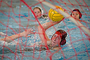 Sara Hannemann '14 winds up for a shot during a recent Grinnell Women's water polo match against Augustana College. BEN BREWER/Grinnell College