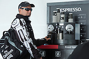Emirates Team New Zealand tactician, Ray Davies makes himself a Nespresso coffee before the morning team meeting at the hospitality area in San Francisco. 23/8/2012