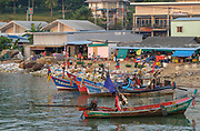 Thailand, Koh Samui, East Coast Baan Hua Thanon. A Muslim fishing village. Boats moored in harbour