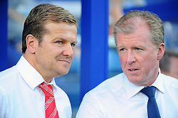 Swindon Town Manager, Mark Cooper talking with Steve McClaren  - Photo mandatory by-line: Seb Daly/JMP - Tel: Mobile: 07966 386802 27/08/2013 - SPORT - FOOTBALL - Loftus Road - London - Queens Park Rangers V Swindon Town -  Capital One Cup - Round 2