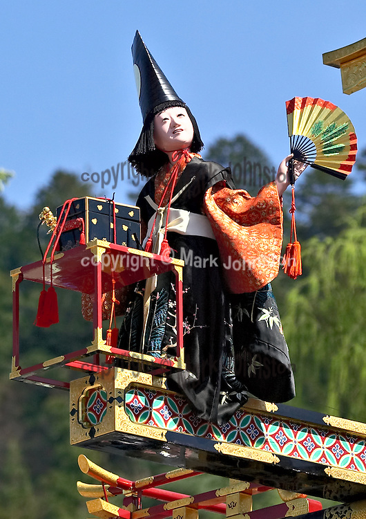 The annual Spring festival at Hida Takayama in the highlands of central Japan features processions of large wheeled floats dating from the 16th century.<br /> <br /> These floats are sumptuously decorated with intricate carvings, rich tapestries, and lacquer finishes.  Many feature marionettes such as the one shown here that are controlled from inside the float via complex arrangements of cables and levers.