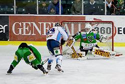 Krisztian Palkovics (SAPA Fehervar AV19, #24) vs Jean-Philippe Lamoureux (HDD Tilia Olimpija, #1) during ice-hockey match between HDD Tilia Olimpija and SAPA Fehervar AV19 at second match in Quarterfinal  of EBEL league, on Februar 21, 2012 at Hala Tivoli, Ljubljana, Slovenia. (Photo By Matic Klansek Velej / Sportida)