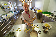 "South Tyrol. Toblach/Kandellen (Dobbiaco/Gandelle). Seiterhof restaurant and hotel. Owner and Chef Herbert Kamelger preparing traditional ""Schlutzkrapfen"" (dumplings filled with cheese and herbs)."