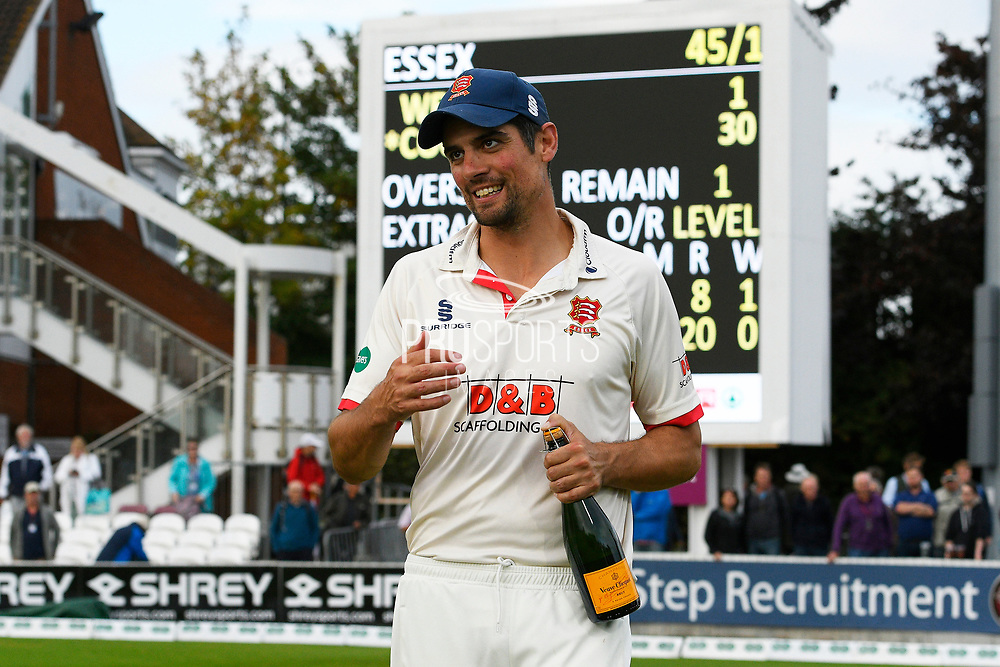 Alastair Cook of Essex with a bottle of Champaigne ready for the trophy celebrations during the Specsavers County Champ Div 1 match between Somerset County Cricket Club and Essex County Cricket Club at the Cooper Associates County Ground, Taunton, United Kingdom on 26 September 2019.