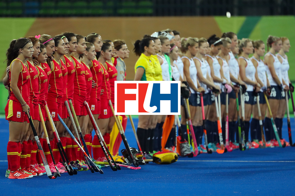 RIO DE JANEIRO, BRAZIL - AUGUST 15:  Spain and Great Britain stand for the national anthems before the quarter final hockey game on Day 10 of the Rio 2016 Olympic Games at the Olympic Hockey Centre on August 15, 2016 in Rio de Janeiro, Brazil.  (Photo by Christian Petersen/Getty Images)