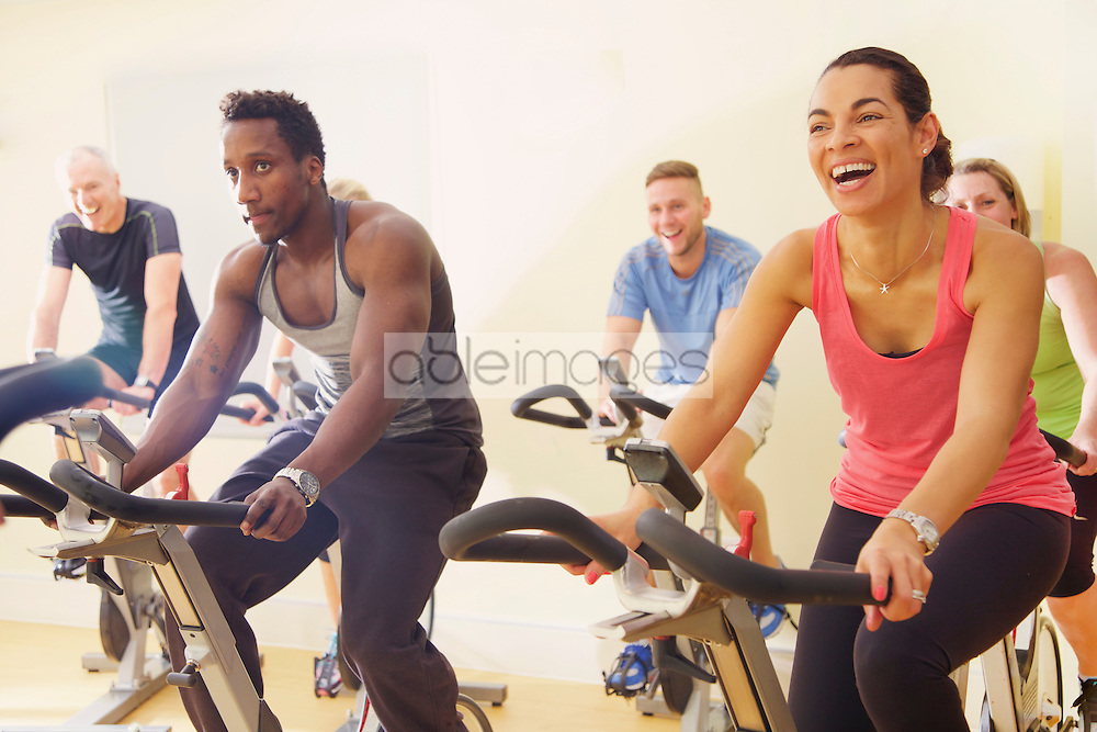 Group of People Using Exercise Bicycles at Fitness Class