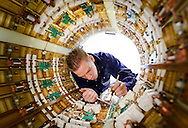 Dave Lemmens, a Philips Healthcare engineer, works on the body coil of an MRI scanner, at the Philips Healthcare production facility, in Best, the Netherlands. (Photo © Jock Fistick)