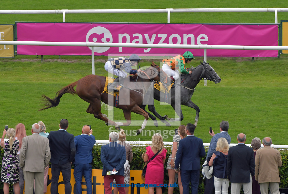 Baron Run ridden by Mark Simms (blue and yellow check) wins Betfair Clock Tower Cup Racing Welfare Charity race  during the Racing Welfare Charity Raceday meeting at Doncaster Racecourse, Doncaster<br /> Picture by Martin Lynch/Focus Images Ltd 07501333150<br /> 07/07/2017