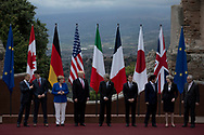Italy, Taormina: World leaders (from left to right) President of the European Council Donald Tusk,  canadian Prime Minister Justine Trudeau, German Chancellor Angela Merkel,U.S. President Donald Trump, Italian Prime Minister Paolo Gentiloni, French president Emmanuel Macron,Japanese prime minister Shinzo Abe, British prime minister Teresa May and President of the European Commission Jean -Claude Junker pose for a photo group at the Ancient Theatre of Taormina ahead the G7 Summit on May 26, 2017.