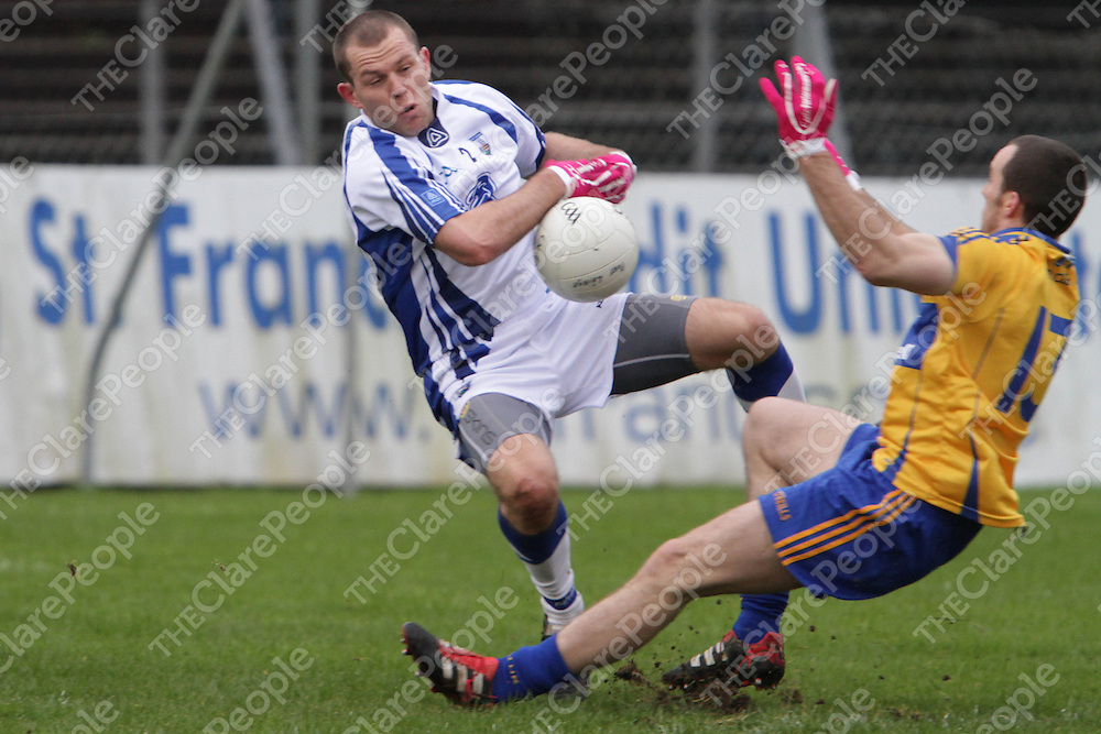 Clare's Rory Donnelly & Waterford's Kieran Connery collide as they battle for possession in their Division 4 clash @ Cusack Park. - Photograph by Flann Howard