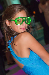 teenage girl in a gown and fun glasses at her Bat Mitzvah party