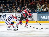 KELOWNA, CANADA - OCTOBER 10:  MacKenzie Johnston #22 of the Kelowna Rockets makes a pass while checked by Collin Valcourt #19 of the Spokane Chiefs as the Spokane Chiefs visit the Kelowna Rockets on October 10, 2012 at Prospera Place in Kelowna, British Columbia, Canada (Photo by Marissa Baecker/Shoot the Breeze) *** Local Caption ***