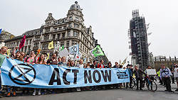 "© Licensed to London News Pictures. 23/04/2019. LONDON, UK.  Activists arrive at Parliament Square during ""London: International Rebellion"", on day nine of a protest organised by Extinction Rebellion.  Protesters are demanding that governments take action against climate change.  Police have issued a section 14 order for Parliament Square and expect that the occupation of the square will have concluded by the end of the day.  Photo credit: Stephen Chung/LNP"