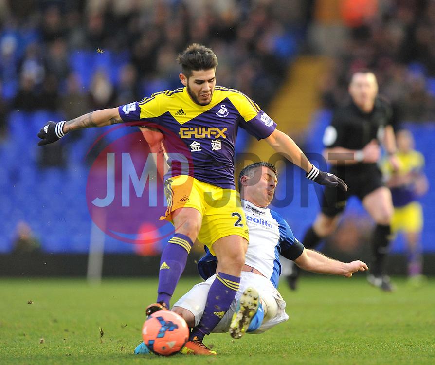 Birmingham City's Chris Burke tackles Swansea City's Alejandro Pozuelo - Photo mandatory by-line: Alex James/JMP - Tel: Mobile: 07966 386802 25/01/2014 - SPORT - FOOTBALL - St Andrew's - Birmingham - Birmingham City v Swansea City - FA Cup - Forth Round