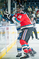 KELOWNA, CANADA - OCTOBER 7: Tate Coughlin #18 of Kelowna Rockets collides with a player of the Swift Current Broncos on October 7, 2014 at Prospera Place in Kelowna, British Columbia, Canada.  (Photo by Marissa Baecker/Getty Images)  *** Local Caption *** Tate Coughlin;