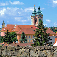 Introduction to Eger, Hungary <br /> Hungary has a population of almost 10 million people; over 25% live in Budapest. Compared to the country&rsquo;s capital city, Eger is small. Its 55,000 residents rank it the 19th city by size. That is also part of its charm. This gem in the northeast near the border of Slovakia offers fabulous architecture, cobblestone alleys, a lively town square, a millennium of fascinating history, a Medieval castle plus some of Hungary&rsquo;s best wine and food. This visual enticement shows the Minorite Church in the center and the Cathedral of Eger on the left.