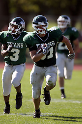 04 October 2008: Dan Rogers gets position on Jake Smith and intercepts a pass thrown by Evan Jones. Rogers proceeds upfield in a battle between the Carthage Red Men and the Illinois Wesleyan University Titans, Game action was at Wilder Field on the campus of Illinois Wesleyan University in Bloomington Illinois.
