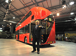 ©London News pictures...11/11/2010. Boris Johnson at the rear of the bus.  Boris Johnson, London's Mayor, unveils a life size mock up of a new bus for London, today (11/11/10). The mock up gives Londoners the first glimpse of how the bus will look when it is put into service in 2012