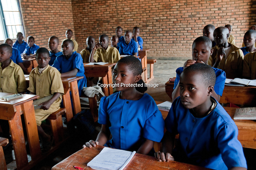 Since 2004 Rwanda has expanded the education system with thousands of new classrooms and teachers. Rwanda provides 9 years of free education for all children. Many schools have two shifts. English has replaced French as the second language.