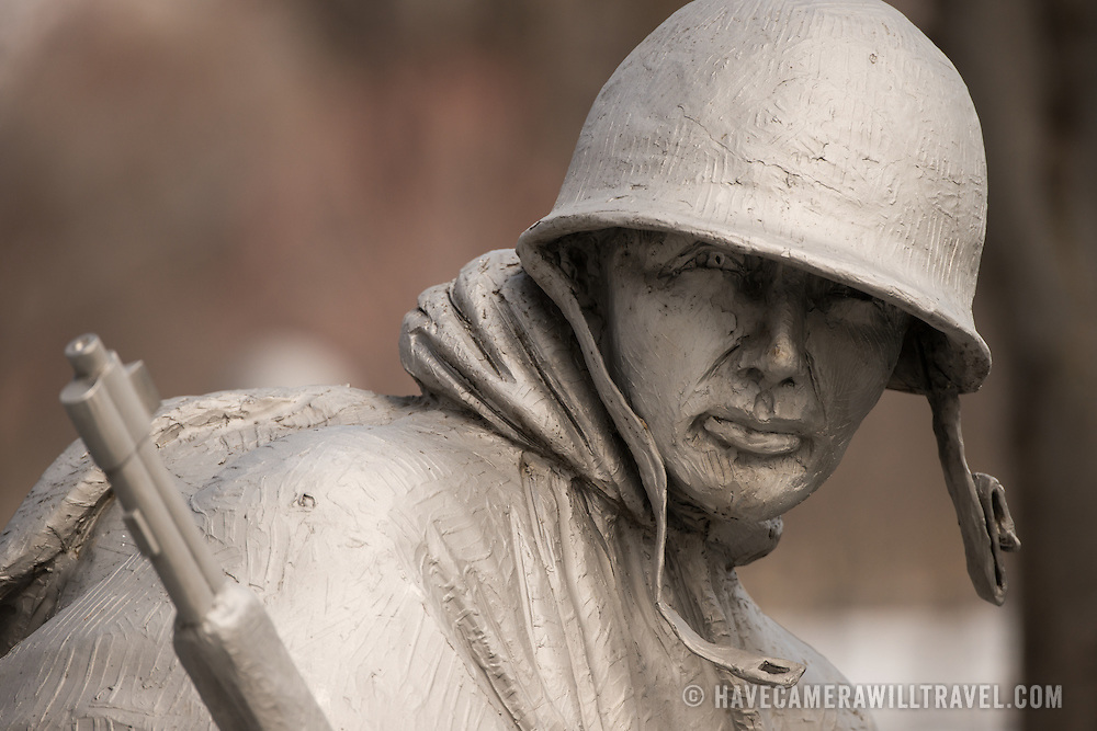 Some of the 19 stainless steel statues that are part of the Korean War Veterans Memorial on the National Mall in Washington DC. Designed by Frank Gaylord, the statues are slightly larger than life and each weighs nearly 1,000 pounds. The figures represent a squad on patrol, drawn from each branch of the armed forces. They are dressed in full combat gear, dispersed among strips of granite and juniper bushes which represent the rugged terrain of Korea.