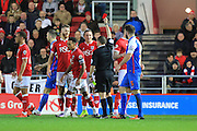 Bristol City defender Nathan Baker is shown a red card during the Sky Bet Championship match between Bristol City and Blackburn Rovers at Ashton Gate, Bristol, England on 5 December 2015. Photo by Jemma Phillips.
