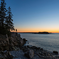 A hiker at dawn on the Schoodic Peninsula in Maine's Acadia National Park.