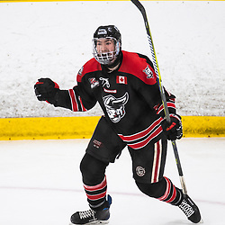 TORONTO, ON - APR 10, 2018: Ontario Junior Hockey League, South West Conference Championship Series. Game seven of the best of seven series between the Georgetown Raiders and the Toronto Patriots, Andrew Cordssen-David #7 of the Georgetown Raiders celebrates a goal scored during the first period.<br /> (Photo by Kevin Raposo / OJHL Images)