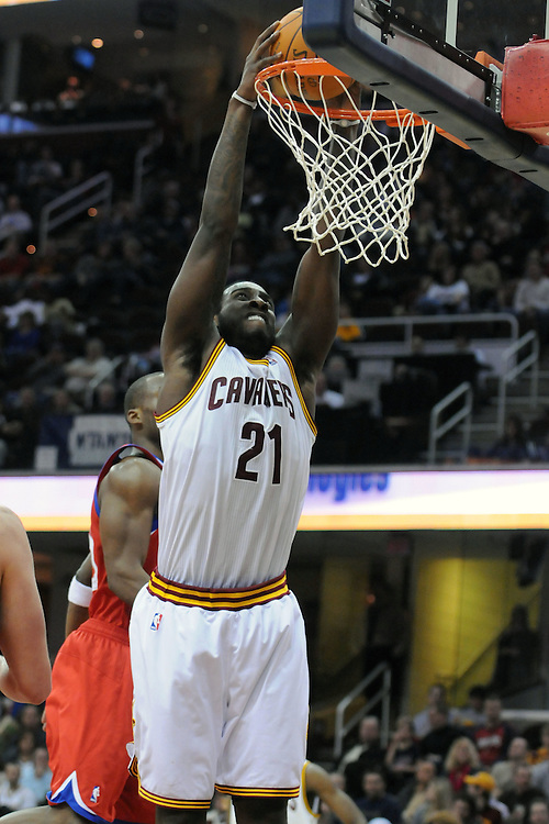 Feb. 27, 2011; Cleveland, OH, USA; Cleveland Cavaliers power forward J.J. Hickson (21) dunks during the third quarter against the Philadelphia 76ers at Quicken Loans Arena. The 76ers beat the Cavaliers 95-91.Mandatory Credit: Jason Miller-US PRESSWIRE