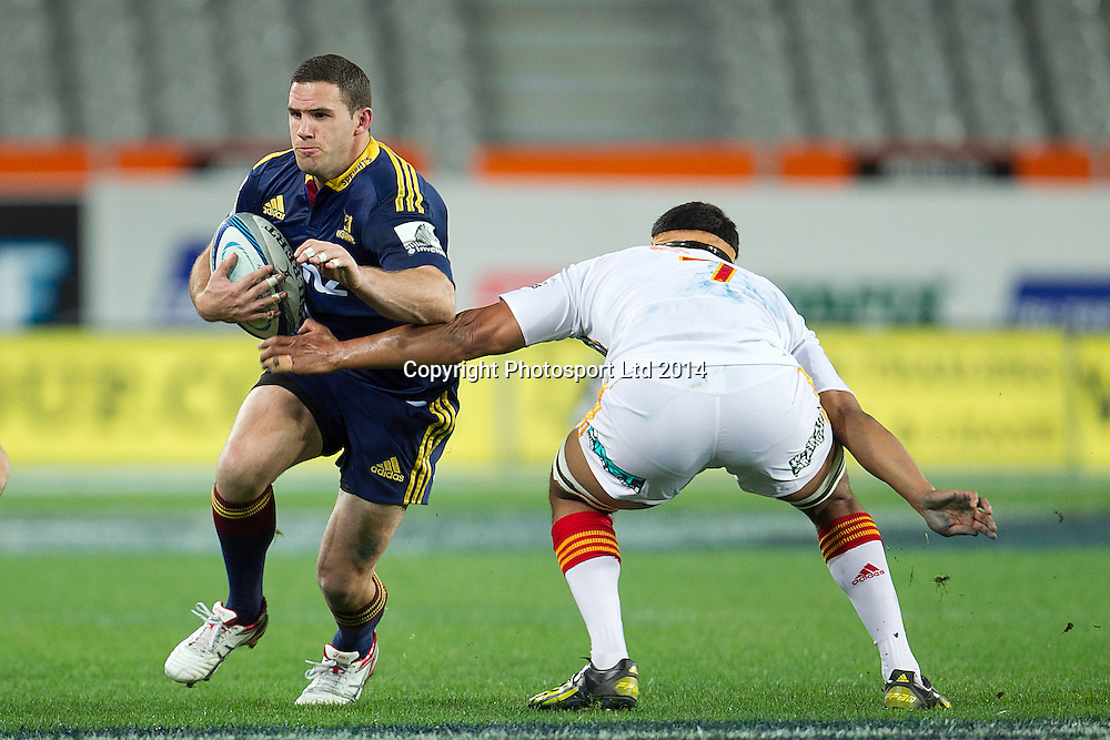 Shaun Treeby of the Highlanders makes a break during the Super Rugby game between The Chiefs and The Highlanders, Forsyth Barr Stadium, Dunedin. 27 June 2014. Photo: Teaukura Moetaua/www.photosport.co.nz