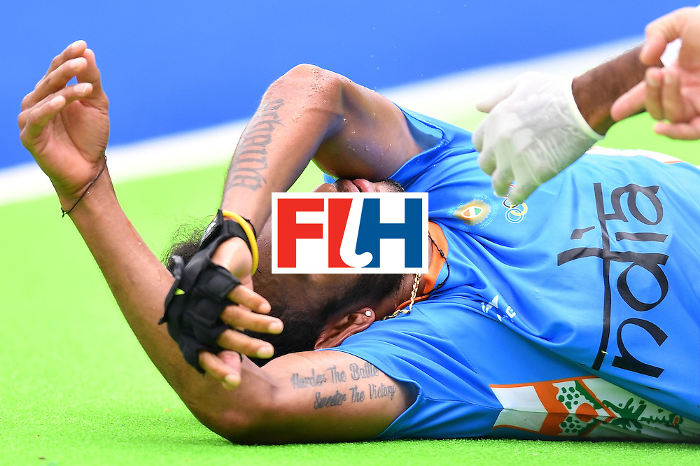 India's Sunil Sowmarpet is injured during the mens's field hockey India vs Canada match of the Rio 2016 Olympics Games at the Olympic Hockey Centre in Rio de Janeiro on August, 12 2016. / AFP / MANAN VATSYAYANA        (Photo credit should read MANAN VATSYAYANA/AFP/Getty Images)