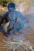 Hadzabe hunter at the fireplace. Lake Eyasi, northern Tanzania.