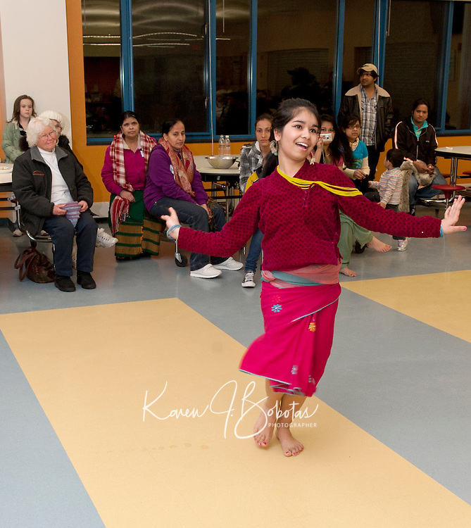 Anjana Dulal performs a traditional dance during the Martin Luther King celebration held at the Laconia Middle School Sunday evening.  (Karen Bobotas/for the Laconia Daily Sun)