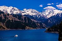 Heavenly Lake of Tianshan (in the Tian Shan Mountain range) sits at 6,257 feet (1907 meters). Xinjiang Province, northwest China.