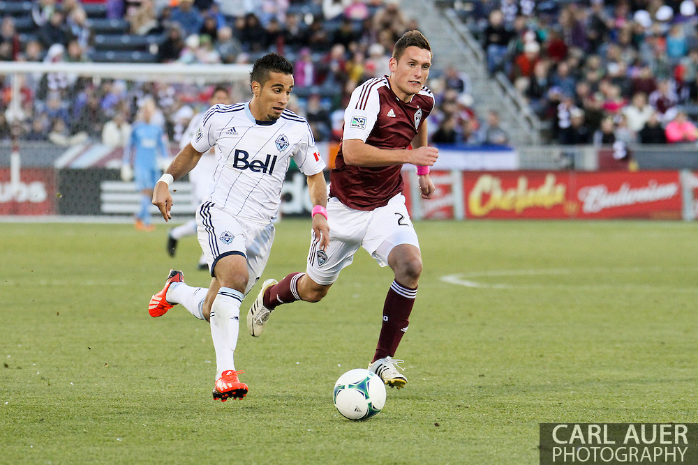 October 19th, 2013:  Vancouver Whitecaps FC forward Camilo Sanvezzo (7) attempts to drive the ball past Colorado Rapids midfielder Shane O'Neill (27) in the second half of action in the MLS Soccer Match between the Vancouver Whitecaps FC and the Colorado Rapids at Dick's Sporting Goods Park in Commerce City, Colorado