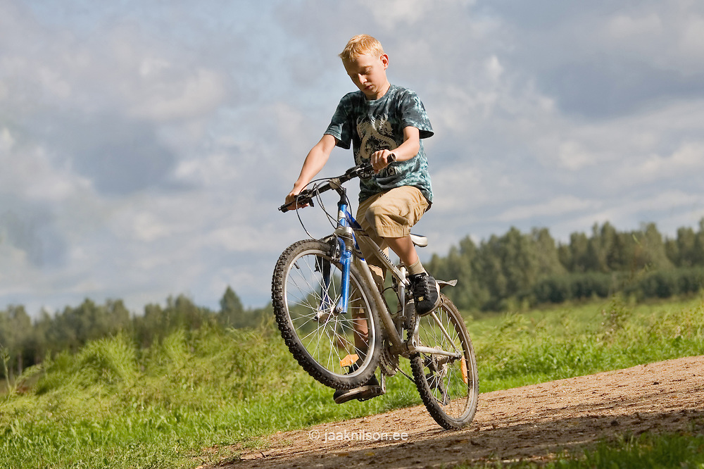 Teenage Boy Riding Bicycle