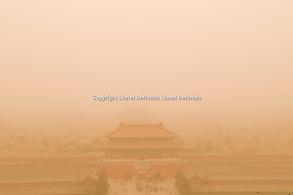 Dust storm over the Forbidden City, Beijing, China.