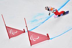 HERNANDEZ Cecile FRA competing in ParaSnowboard, Snowboard Banked Slalom at  the PyeongChang2018 Winter Paralympic Games, South Korea.