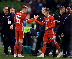DUBLIN, IRELAND - Tuesday, October 16, 2018: Wales' match-winning goal-scorer Harry Wilson (R) celebrates with team-mate David Brooks (L) after the 1-0 victory during the UEFA Nations League Group Stage League B Group 4 match between Republic of Ireland and Wales at the Aviva Stadium. (Pic by David Rawcliffe/Propaganda)