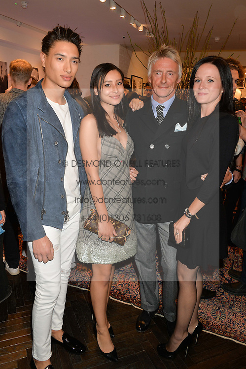 Left to right, NAT WELLER, LEAH WELLER, PAUL WELLER and HANNAH ANDREWS at a party to celebrate the launch of the first European John Varvatos Store, 12-13 Conduit Street, London held on 3rd September 2014.