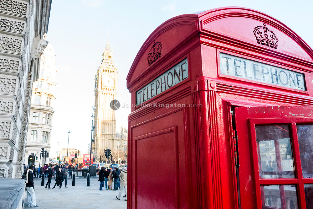 High key shot of a red telephone booth and Big Ben, officially known as the Elizabeth Tower, in London, England.