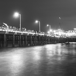 Santa Monica California Pier at night black and white panorama photo. Panoramic photo ratio is 1:3. Copyright ⓒ 2017 Paul Velgos with All Rights Reserved.