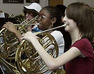 Ferguson Middle School 8th Grade Band members Whitney Smith (center) and Lauren McCallister (right) rehearse at  Beavercreek High School, Tuesday, May 1st.
