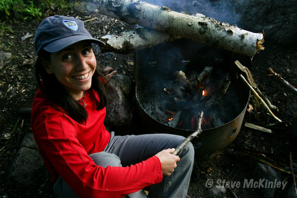 FRONTENAC PROVINCIAL PARK, ON: JULY 7, 2009 -- FRONTENAC --  Emilie Balas works on her campfire during a canoe trip in Frontenac Provincial Park July 7, 2009. ..(Steve McKinley photo).