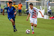 Team USA forward Christian Torres (9) dribbles the ball up the pitch during a CONCACAF boys under-15 championship soccer game, Monday, Aug. 5, 2019, in Bradenton, Fla. The USA defeated Guatemala  2-0 (Kim Hukari/Image of Sport)