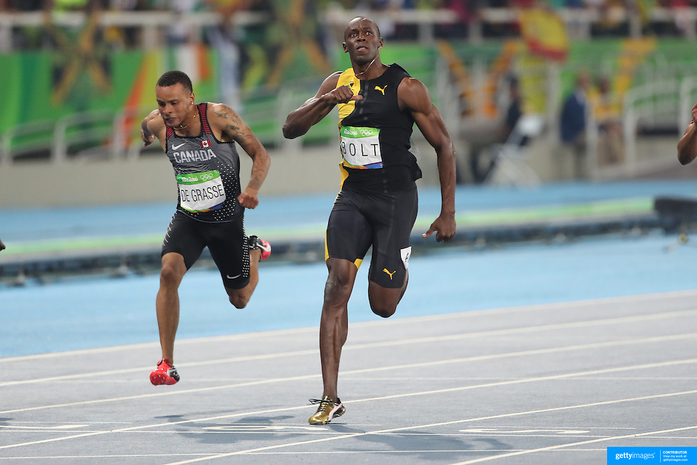 Athletics - Olympics: Day 9  Usain Bolt of Jamaica wins the Men's 100m Final with Andre de Grasse, (left), of Canada in third place at the Olympic Stadium on August 14, 2016 in Rio de Janeiro, Brazil. (Photo by Tim Clayton/Corbis via Getty Images)