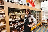 Portrait of confident saleswoman standing in supermarket