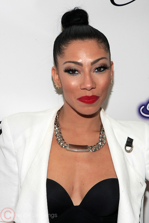 """9 September 2013- New York, NY: Recording Artist Bridget Kelly attends the """" Hair Icon '  Cocktail & Dinner party presented by Beautiful Textures in partnership with BET Networks and Cadillac held at the Mondrian Soho Penthouse on September 9, 2013 in New York City. ©Terrence Jennings"""