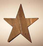 Marolyn Ray hangs this wooden star from her grandparents farm near Spencerville in her living room.